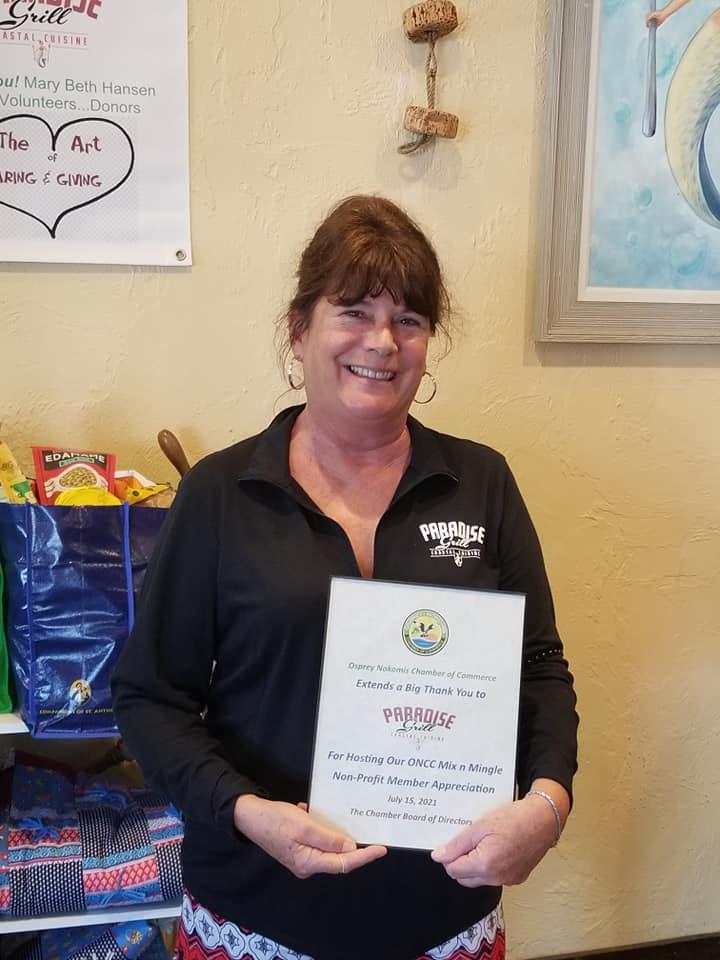Mary Beth Hansen holding certificate